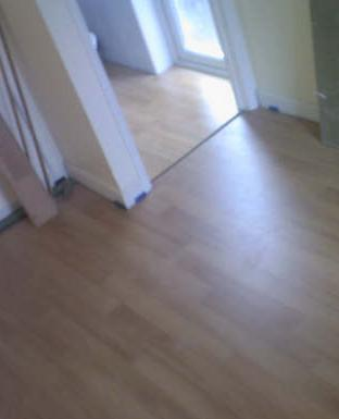 Chris Plumb with a hardwood floor he fitted